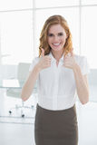 Smiling businesswoman gesturing thumbs up Royalty Free Stock Image
