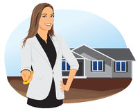 Smiling businesswoman is giving a key. At the background of the house Royalty Free Stock Photos