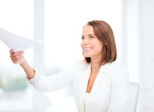 Smiling businesswoman giving papers in office Royalty Free Stock Photography