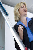 Smiling businesswoman giving presentation in office Stock Image