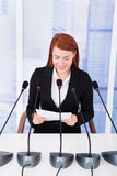 Smiling Businesswoman Giving Speech At Conference Stock Images