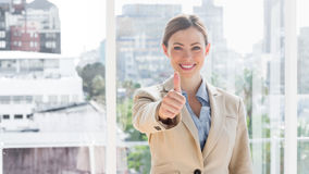 Smiling businesswoman giving thumb up to camera Royalty Free Stock Photo