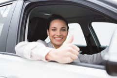 Smiling businesswoman giving thumbs up Stock Photo