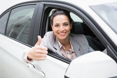 Smiling businesswoman giving thumbs up Stock Photography