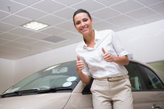 Smiling businesswoman giving thumbs up Stock Photos