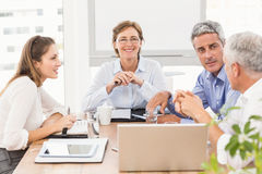 Smiling businesswoman with glasses in a meeting Stock Photos