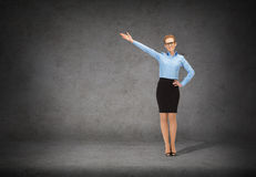Smiling businesswoman in glasses pointing her hand Stock Photography
