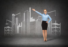 Smiling businesswoman in glasses pointing her hand Royalty Free Stock Photos