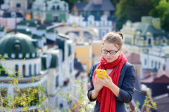 Smiling businesswoman in glasses using smartphone in city Stock Image