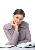 Smiling Businesswoman with Hand Under ner Chin Royalty Free Stock Image