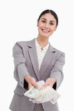 Smiling businesswoman handing over money Royalty Free Stock Photography