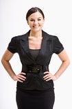 Smiling businesswoman with hands on hips. Portrait of a smiling businesswoman with her hands on her hips Royalty Free Stock Photography