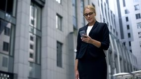 Smiling businesswoman happy to read message on smartphone with good news, salary. Stock photo stock images