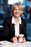 Smiling businesswoman having coffee, outdoor Royalty Free Stock Photo