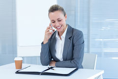 Smiling businesswoman having phone call Stock Photography