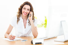 Smiling businesswoman having phone call Stock Image