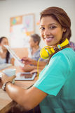 Smiling businesswoman with headphones in a meeting Stock Photography