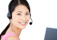 Smiling businesswoman with headset on Royalty Free Stock Photos