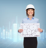 Smiling businesswoman in helmet showing blueprint Stock Images