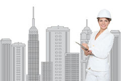 Smiling businesswoman in helmet studying the sketch of future business centre. Stock Photography