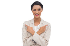 Smiling businesswoman with her arms crossed and fingers pointing Stock Images