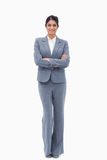 Smiling businesswoman with her arms folded Stock Images