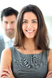 Smiling businesswoman and her colleague in the back Stock Photo