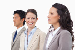 Smiling businesswoman between her colleagues Royalty Free Stock Photos
