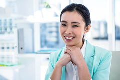Smiling businesswoman at her desk Stock Images
