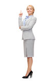 Smiling businesswoman with her finger up Stock Photography