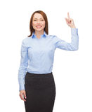 Smiling businesswoman with her finger up Stock Photo