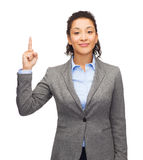 Smiling businesswoman with her finger up Stock Image
