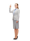 Smiling businesswoman with her finger up Royalty Free Stock Photo