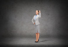 Smiling businesswoman with her finger up Royalty Free Stock Photography