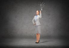 Smiling businesswoman with her finger up Royalty Free Stock Image