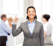 Smiling businesswoman with her finger up at office Royalty Free Stock Photo