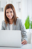 Smiling Businesswoman at Her Laptop Royalty Free Stock Image