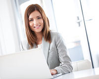 Smiling Businesswoman at Her Laptop Stock Photo