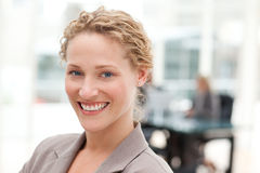 Smiling businesswoman in her office Stock Photo