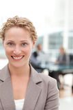 Smiling businesswoman in her office Stock Images