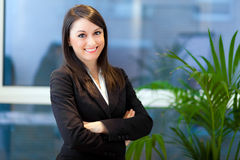 Smiling businesswoman in her office Stock Image