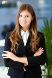 Smiling businesswoman in her office Stock Photos