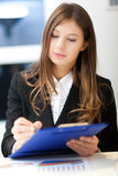 Smiling businesswoman in her office Royalty Free Stock Photography