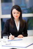 Smiling businesswoman in her office Royalty Free Stock Photos