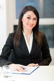 Smiling businesswoman in her office Royalty Free Stock Image