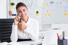Smiling businesswoman on her phone Stock Photography
