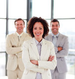 Smiling businesswoman with her team Royalty Free Stock Photo