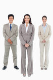Smiling businesswoman with her team behind her Royalty Free Stock Image