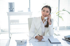 Smiling businesswoman on her telephone Royalty Free Stock Images