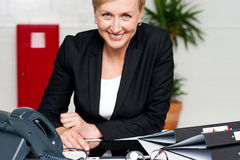 Smiling businesswoman at her work desk Stock Images